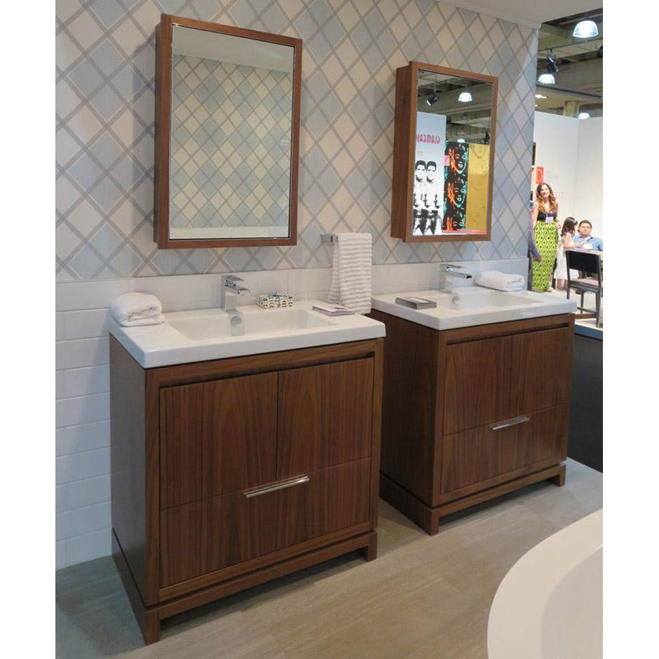 Lacava Free-standing under-counter vanity with finger pulls across top doors and polished chrome pull across bottom drawer. Bathroom Sink # 5233 sold separ