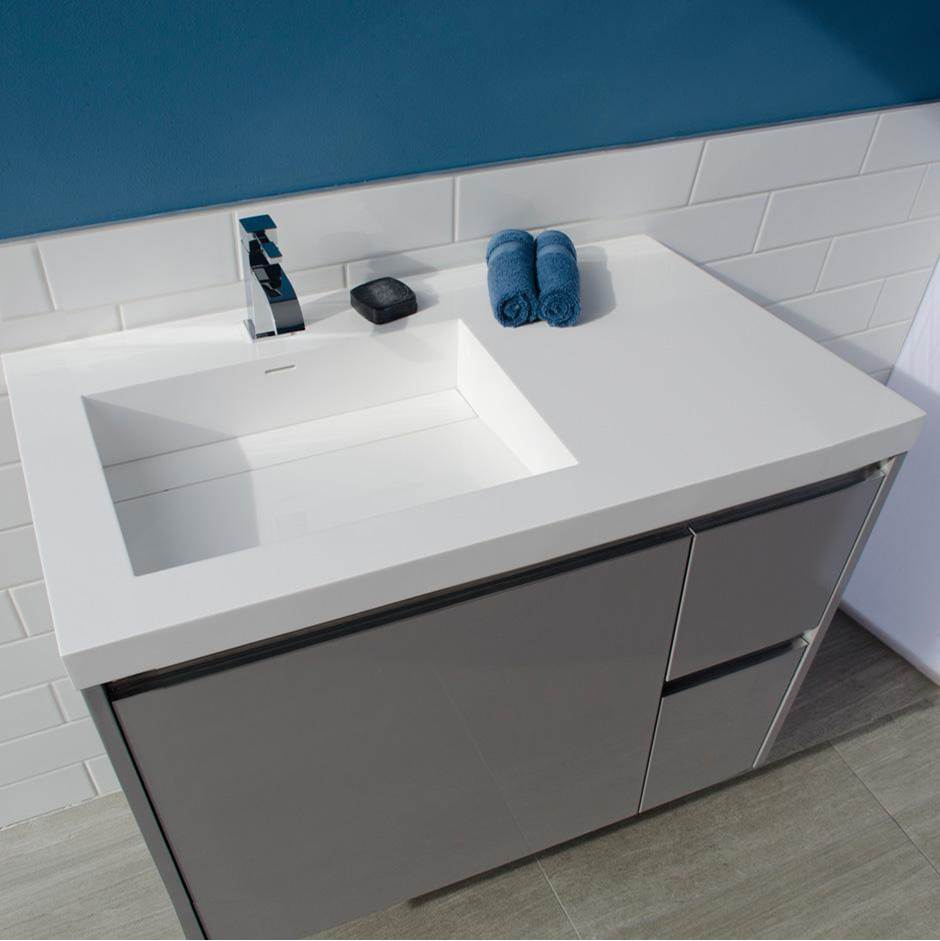 Lacava Vanity-top Bathroom Sink made of solid surface, with an overflow and decorative drain cover. Sink is on the left .01 - one faucet hole, W: 36'', D:
