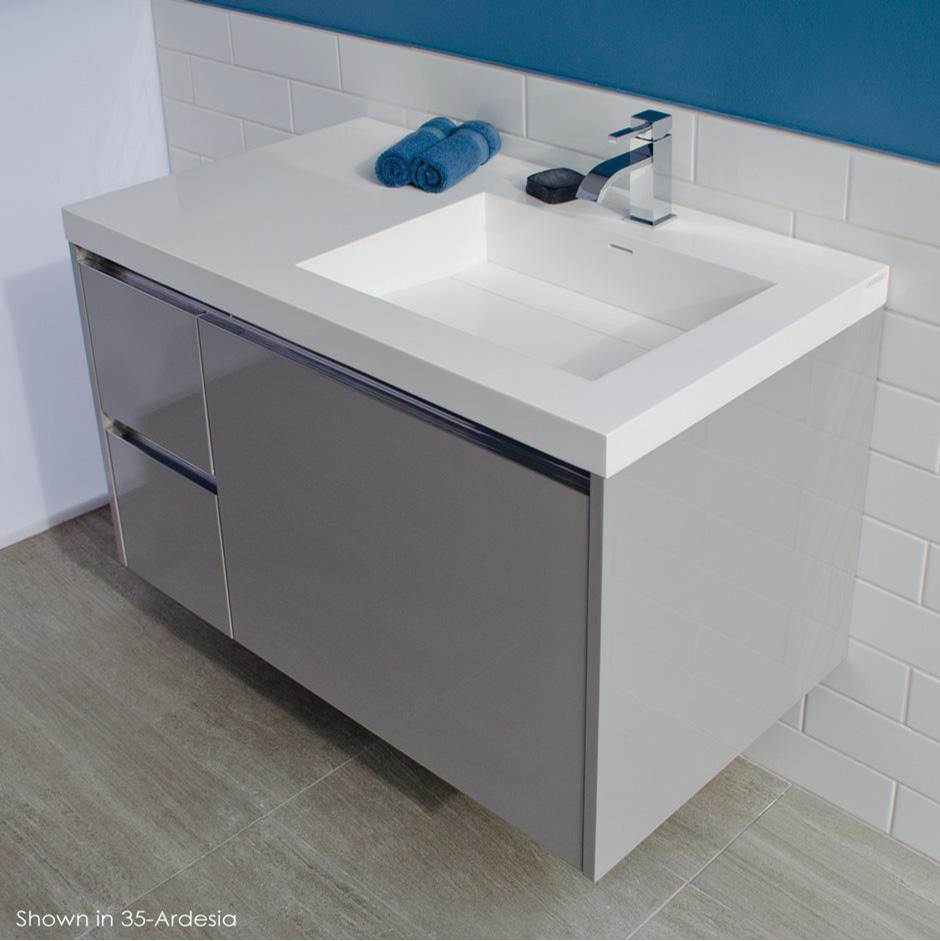 Lacava Wall-mount under counter vanity with three drawers, Bathroom Sink is on the right. The drawer under Bathroom Sink has a notch for pluming. Bathroo